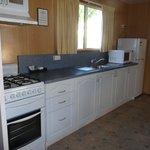 Kitchen, full stove, large fridge