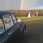 Wedding with rain and rainbows