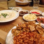 Grilled chicken breast with beans and rice. With humus and homemade salads