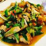 Stir-fried Chinese leek with pork crackling (Siew yuk)