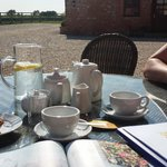 enjoying the complimentary tea and cake in the beautiful  sunshine :)