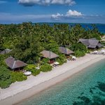 view of Wakatobi's Ocean Bungalow fronting the beach and House Reef