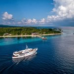 Pelagian luxury yacht passes by Wakatobi Dive Resort on the way out for 7-day cruise