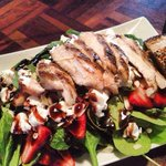 Spinach salad with goat cheese, strawberries, almond slivers, grilled chicken and a balsamic gla