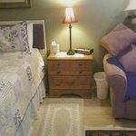 Side table next to bed and sofa