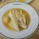 Branzino in white wine sauce.