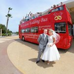 The Big Red Wedding bus at the front of the hotel
