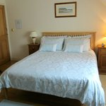 Coastal Room's blue damask bedlinen & oak furniture