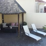 Shaded lapa area for relaxing by the pool