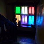 the colourful window on the landing inside The Manor House