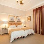 The large double bedroom en suite at Doncaster Cottage