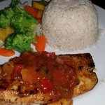Blackened Mahi Mahi topped with Mango Salsa served with Coconut Rice & Vegetables