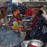 A herero woman selling 'pap' (maize porridge)