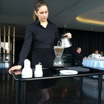Our server preparing our imported coffee