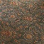 Thin warn room carpet