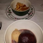 Two desserts - tradtional crème caramel (top) and poached pear in red wine.