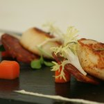 Seared Scallops on a bed of Crispy Spanish Sausage and Fennel Puree