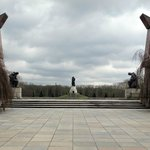 Two stylised Soviet flags lowered in tribute mark the entry to the memorial itself