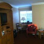 Room 2 with mini fridge, tea/coffee machine and three windows