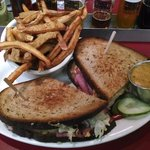 Corned beef Reuben with curry sweet potato fries