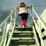 Future scientist climbing the ladder aboard The Knorr