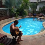 Aussie Mal strumming one out at the pool
