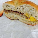 Sausage, egg & cheese on a Rosemary bagel. Half of it gone! Nomnomnom!