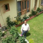 A view of the Flower laden Lawn from the Patio (Balcony) of Room No.102