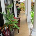 Verandah at hotel entry, umbrellas for guests