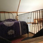 camera da letto nel soppalco del cottage