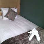 Bed with welcome towels in elephant shape
