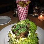 Artisan fries and a salad of butter lettuce, warm lentils, roasted lamb neck, and yogurt