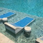 Lounge chairs built into the pool
