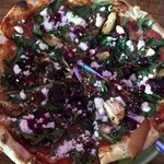 One great and unique pizza. Beet, brussels sprout, kale, onion, feta cheese pizza.