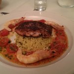 Blackened fillet of hake with prawns, lemon couscous and tomato and chilli salsa.