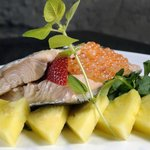 Poached fillet of adriatic trout with strawberries and pineapple