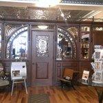 Ornate, restored, pharmacy front.