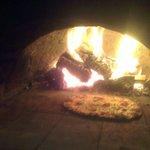 Woodfire pizza w/ local salami pickled chilli and onion.