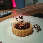 Chocolate and cherry flan with chantilly cream