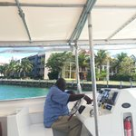 Water Taxi Driver and the Pelican Bay rooms behind him