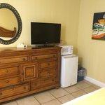 another view of dresser, tv, fridge