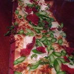 Prosciutto and asparagus flatbread with Camembert cheese.