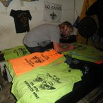 Ginski signing shirts at the Skid Row Bar Utila