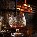 Brandy by the inglenook fireplace