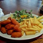 Scampi and chips with salad, coleslaw and tartare sauce on the side.  Delicious.