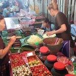 Local food hawker (spicy green papaya salad)
