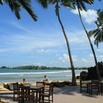 View of outdoor dining area, beach and sea. Paradise