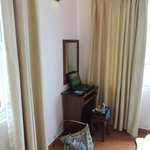 The complimentary laptop and desk