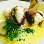 Pan fried fresh sea bass fillet and monk fish loin wrapped in Parma ham with wild garlic,spinach