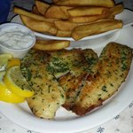 Grilled Tilapia with steak fries.